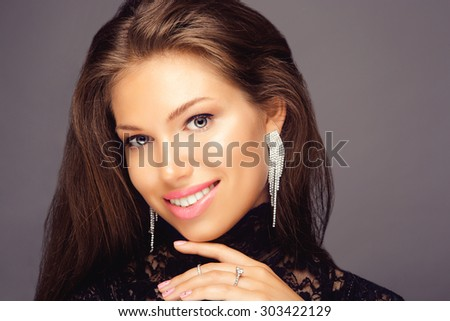 Portrait of Beautiful Brunette Woman with Long Hair and Clean Skin - stock photo