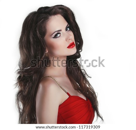 Portrait of beautiful brunette woman with red lips and curly hairs in dress - stock photo