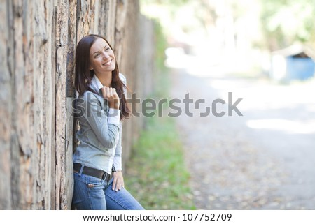 portrait of beautiful brunette young woman outdoor