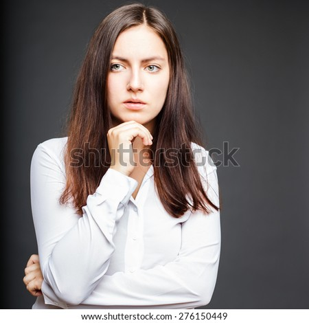 Portrait of beautiful brunette young woman with emotional face and pose