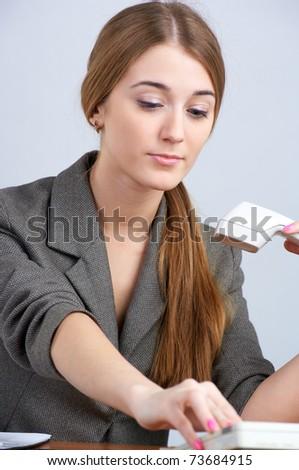 Portrait of beautiful business woman calling by landline phone - stock photo