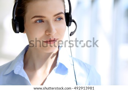 Portrait of beautiful business woman in headset. Call center operator