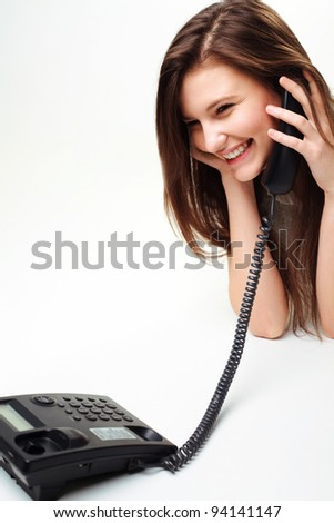 Portrait Of Beautiful business woman on phone call over white background - stock photo