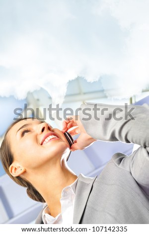 Portrait of beautiful business woman on the phone at modern building. Lots of copyspace - stock photo