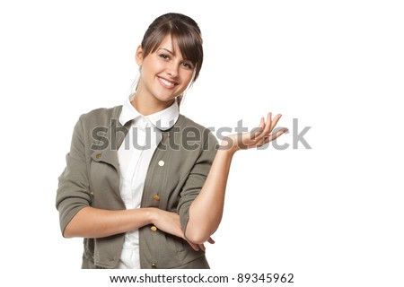 Portrait of beautiful business woman showing copy space over white background - stock photo