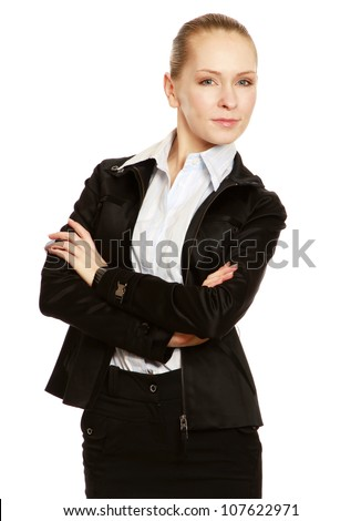 Portrait of beautiful business woman standing with folded arms