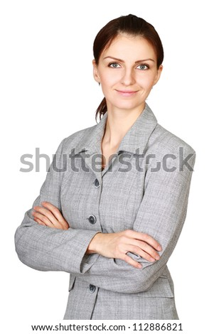 Portrait of beautiful business woman standing with folded arms, isolated in white background - stock photo