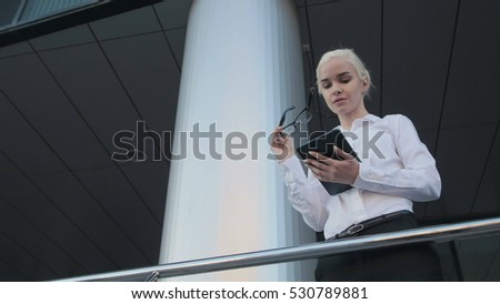 Portrait of Beautiful Business Woman Using Tablet PC Outside  Center