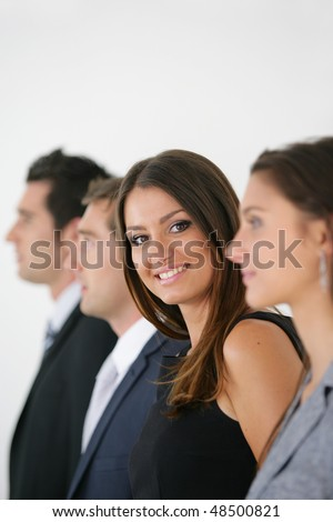 Portrait of beautiful business woman with work team