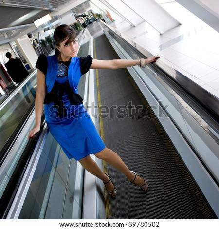 Portrait of beautiful businesswoman indoor glass corridor - stock photo
