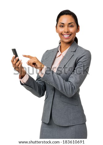 Portrait of beautiful businesswoman text messaging on smart phone over white background. Vertical shot.