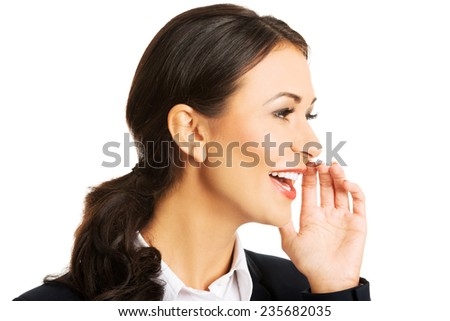 Portrait of beautiful businesswoman whispering to someone. - stock photo