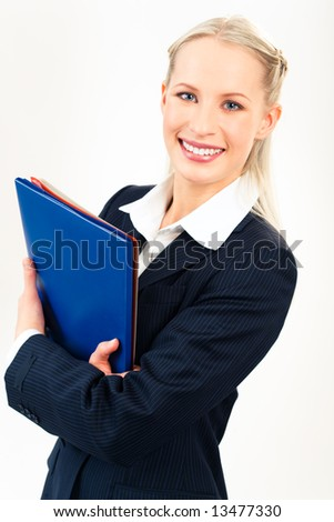 Portrait of beautiful businesswoman with folders looking at camera - stock photo