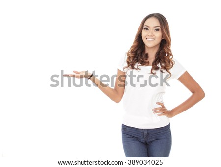 portrait of beautiful casual woman presenting a copy space isolated on white background