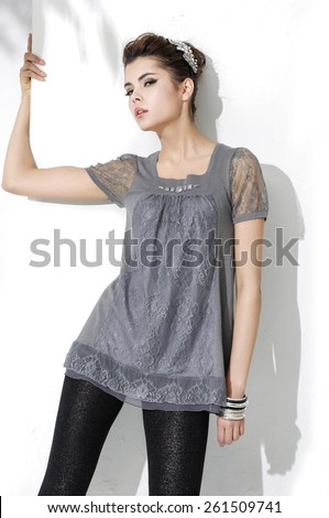 portrait of beautiful casual young fashion model shot in studio - stock photo