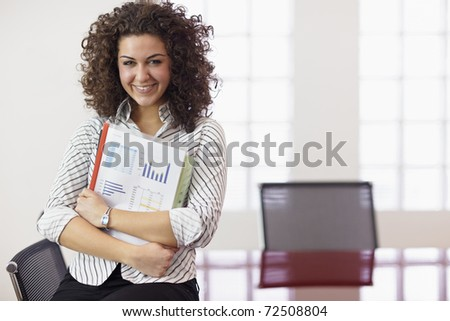 Portrait of beautiful caucasian businesswoman smiling in office, leaning on meeting room table. Horizontal shape, front view, copy space