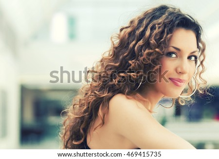 Portrait of beautiful caucasian girl with curly hair