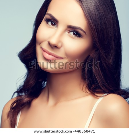 Portrait of beautiful cheerful smiling young woman - stock photo