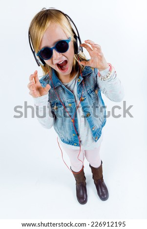 Portrait of beautiful child listening to music with digital tablet. - stock photo