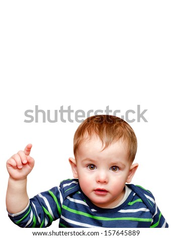 Portrait of beautiful child pointing finger - stock photo