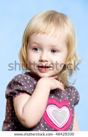 Portrait of beautiful child posing to camera