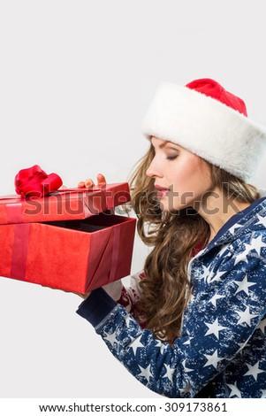 Portrait of Beautiful Christmas Woman hold christmas gift box - stock photo