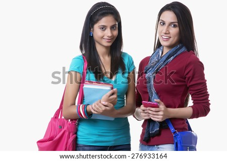 Portrait Of Beautiful College Students With Books And Bags Against White Background