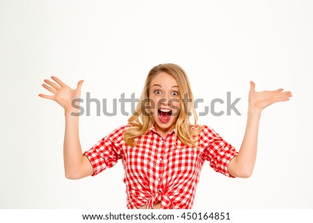 Portrait of beautiful country girl surprised over white background.