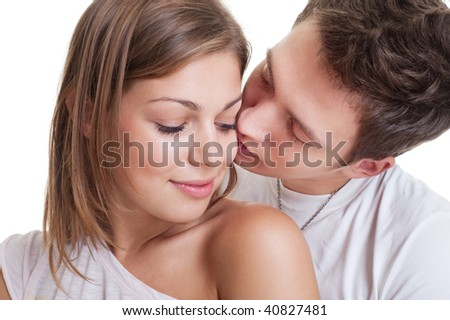 portrait of beautiful couple against white background - stock photo