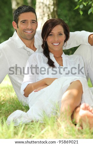 portrait of beautiful couple dressed in white - stock photo