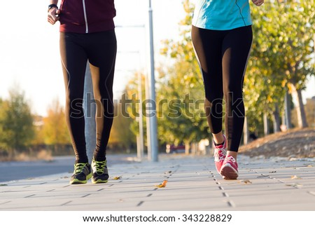 Portrait of beautiful couple running in the street. - stock photo