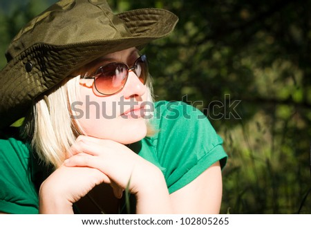 Portrait of beautiful cowgirl outdoor