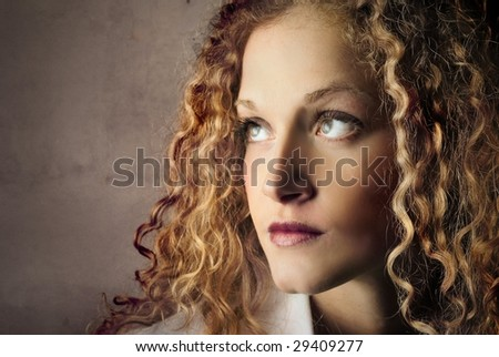 portrait of beautiful curly girl - stock photo