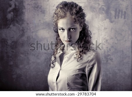portrait of beautiful curly girl grey colored - stock photo