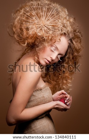 portrait of beautiful curly girl on a beige background - stock photo