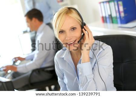 Portrait of beautiful customer service operator - stock photo