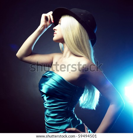 Portrait of beautiful dancing girl in hat - stock photo