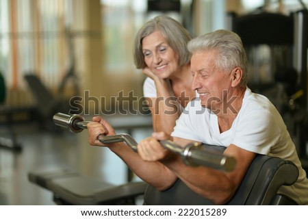 Portrait of beautiful elderly couple in gym - stock photo