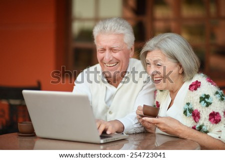 Portrait of beautiful elderly couple on date - stock photo