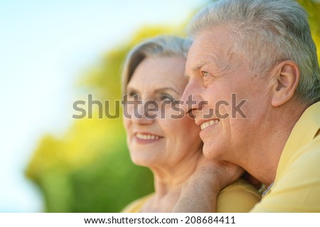 Portrait of beautiful elderly couple outdoor in summer park - stock photo