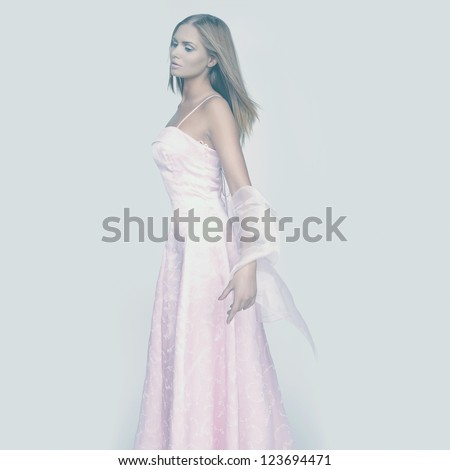 portrait of beautiful elegant blond woman in white dress - stock photo