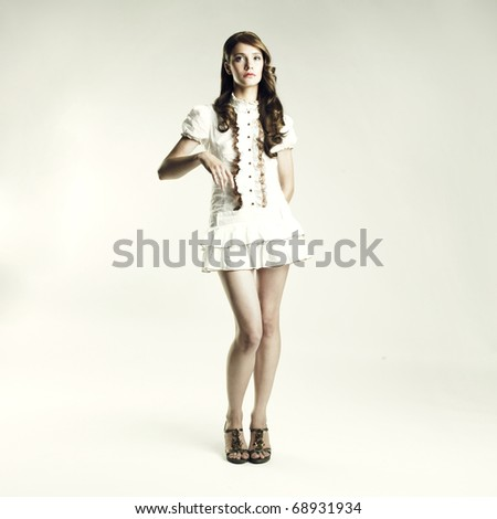 Portrait of beautiful elegant lady on a white background - stock photo