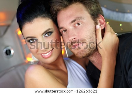 Portrait of beautiful elegant young couple, hugging, smiling. - stock photo