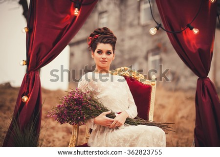 portrait of beautiful elegant young woman in gorgeous dress outdoor - stock photo