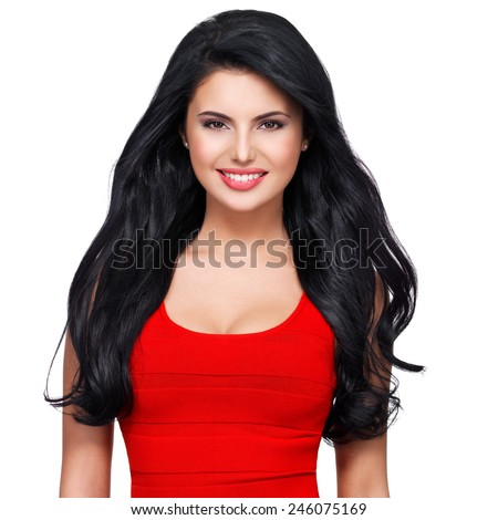 Portrait of beautiful face of an young smiling woman with long brown hair in red dress - stock photo