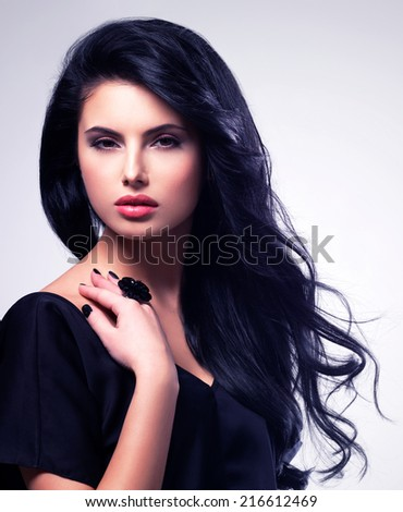 Portrait of beautiful face of an young woman with long brown hair.