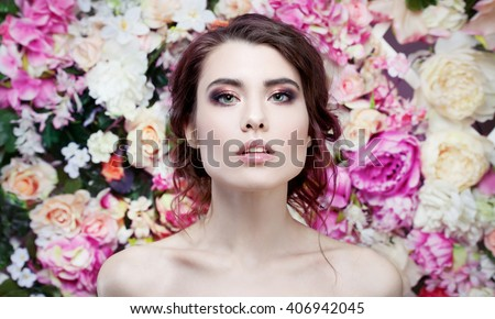 Portrait of  beautiful fashion girl, sweet, sensual. Beautiful makeup and messy romantic hairstyle. Flowers background. Green eyes.  - stock photo
