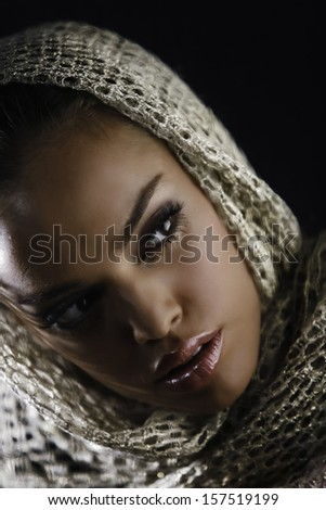 Portrait of beautiful fashion girl with make-up and scarf