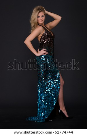Portrait of beautiful fashion woman in blue dress with scales