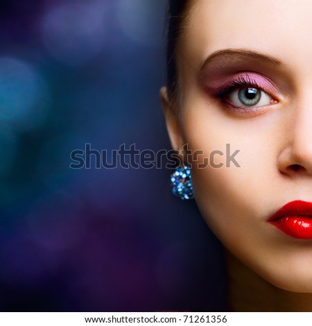 portrait of beautiful fashionable woman on dark background - stock photo